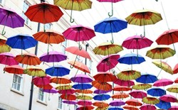 colorful umbrellas hanging from wires