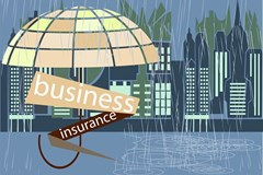umbrella covering words business insurance in city rain storm