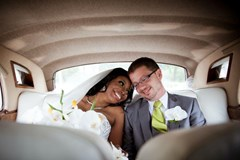 couple in limousine on wedding day