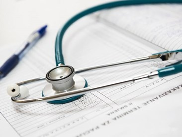 COBRA health insurance: a stethoscope and paperwork are pictured