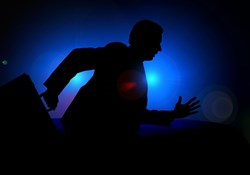 Crime insurance: a shadowy figure with a briefcase runs away