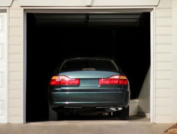 Will my homeowners insurance cover my car if my garage burns down?