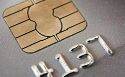closeup of gray credit card chip and numbers 4137