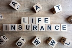 life insurance spelled out with wooden blocks