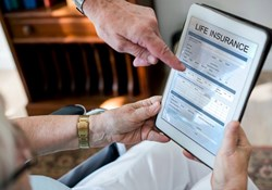 life insurance quote online- elderly people looking at life insurance on a tablet