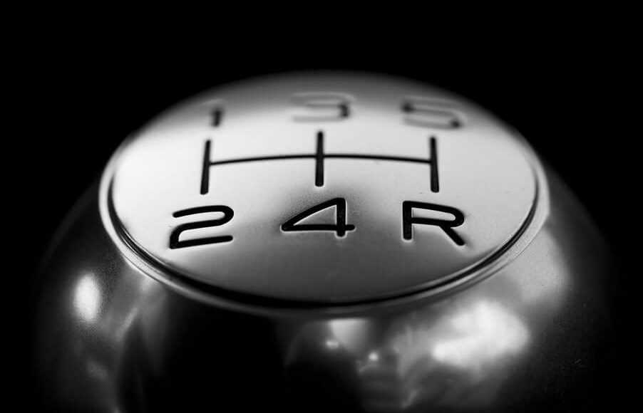 car insurance quotes: a stick shift is shown against a black background