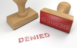 two-rubber-stamps-with-the-word-denied-on-white-rejection