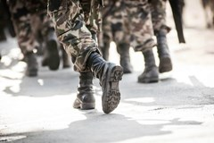 people in military pants and boots walking
